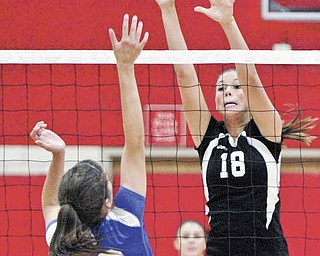 William D Lewis The Vindicator  Canfield's Holly Rolla hits the ball past Poland's Mackenzie Mulligan during Thursday action at Canfield.