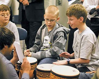 JESSICA M. KANALAS | THE VINDICATOR ..Nick Oblinsky, 12, plays a set of notes by tapping his drum during the SMARTS demo...-30