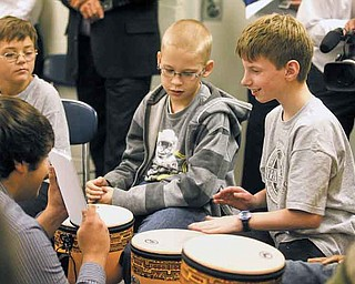 Nick Oblinsky, 12, plays a set of notes by tapping his drum during a demonstration Thursday of the Youngstown State University SMARTS Rhythmic Arts Project at the Potential Development Center.