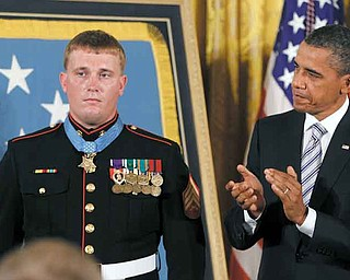 President Barack Obama applauds former Marine Cpl. Dakota Meyer, 23, of Greensburg, Ky., on Thursday after awarding him the Medal of Honor during a ceremony in the East Room of the White House in Washington.
