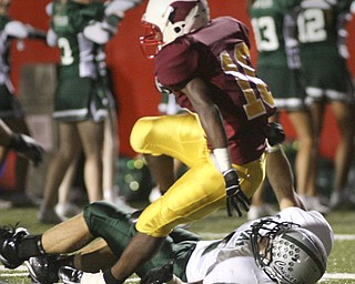 ROBERT  K.  YOSAY  | THE VINDICATOR --..Cardinal Mooneys #10  Justin Ellis-Moore  gets stopped just before he scores  by #15 Lake Zach Hawkins Youngstown Cardinal Mooney played Lake Catholic Cougars at Stambaugh Stadium..--30-..(AP Photo/The Vindicator, Robert K. Yosay)