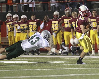 ROBERT  K.  YOSAY  | THE VINDICATOR --.. QB P J  Quinn breaks for a first down in the drive for  their first score  #43 Lake is Jim Szep during first quarter aciton..Mooneys #Youngstown Cardinal Mooney played Lake Catholic Cougars at Stambaugh Stadium..--30-..(AP Photo/The Vindicator, Robert K. Yosay)