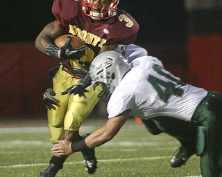 ROBERT  K.  YOSAY  | THE VINDICATOR --..Cardinals #3 Roosevelt Griffen breaks the tackle of Lakes #40 Steve Freiberg on his way to a first quarter first down - Youngstown Cardinal Mooney played Lake Catholic Cougars at Stambaugh Stadium..--30-..(AP Photo/The Vindicator, Robert K. Yosay)