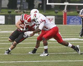 JESSICA M. KANALAS | THE VINDICATOR..Youngstown's tight end Carson Sharbaugh, number 86, is tackled by Illinois State's linebacker Josh Howe and safety Matt Goldsmit during the first quarter...-30