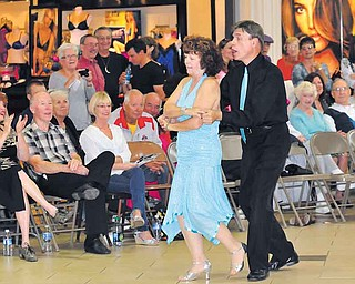 Len Rome and Mary Ann Ebert of Youngstown show off their moves during a ballroom-dancing event Saturday at Eastwood Mall.