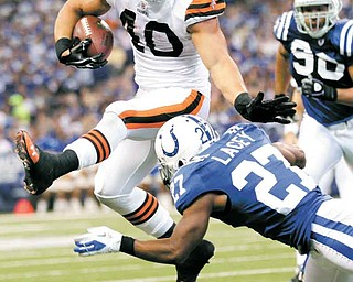 Cleveland Browns running back Peyton Hillis leaps over Indianapolis Colts cornerback Jacob Lacey in the second quarter of an NFL football game in Indianapolis, Sunday, Sept. 18, 2011. (AP Photo/AJ Mast)