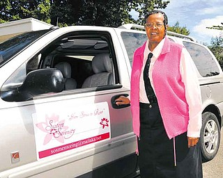 Neoma McDowell of Sisters of Serenity with a van donated to her by Denise Debartolo