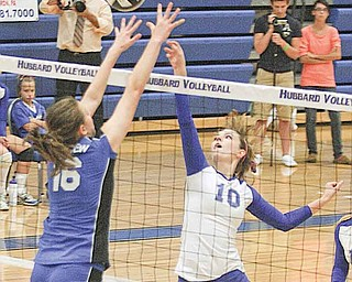 Hubbard's Taylor Greathouse (10) and Lakeview's Marissa Naples battle at the net Monday evening in Hubbard. The Bulldogs defeated the Eagles in four sets.