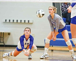 Emily Perry (23) and Kaitlyn Evans (12) of Hubbard make a play on the ball Monday evening in Hubbard. The Eagles won the third set, 30-28, but fell in the fourth.