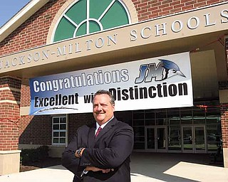Kirk Baker, superintendent of the Jackson-Milton Local School District, stands outside the district's middle and high school building in North Jackson. The district is the only one in Mahoning County to earn a ranking of excellent with distinction by the state.