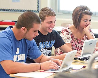 Jackson-Milton students, from left, John Gherardi, Jon Lewis and Breanna Legg, do physics class work on school-provided laptop computers.