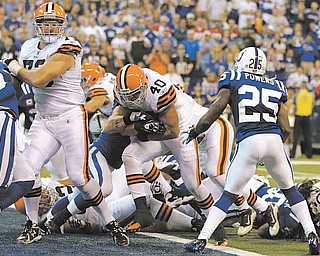 Cleveland Browns running back Peyton Hillis, center, scores in front of Indianapolis Colts cornerback Jerraud Powers (25) in the second quarter of an NFL football game in Indianapolis, Sunday, Sept. 18, 2011. (AP Photo/Darron Cummings)