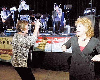Beverly Schumann, left, executive director of teaching and learning at Youngstown city schools, and Kimberly Rose, a teacher at Kirkmere Elementary School, let loose on the dance floor during the Celebrate Forward event Tuesday at the Covelli Centre.