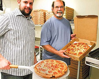 Dave Morgan, right, and his son, Josh, have run the Liberty Belleria Pizza, 5718 Belmont Ave., for about 18 months, but they haven't seen the business they expected. The pizza shop is located about a mile north of the Liberty business district.