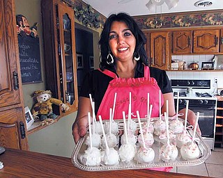 Deanna Fusillo shows off the Sweet D Bites, the signature cake/truffle item and the name of her online bakery. She delivers baked goods both locally and nationwide.
