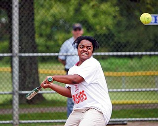 Tracia Collins of Youngstown gets ready to hit for her team during the seventh annual Mahoning County Board of Developmental Disabilities softball game in Poland.