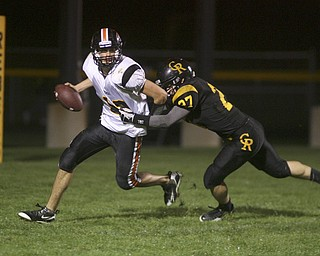 ROBERT  K.  YOSAY  | THE VINDICATOR --..Dogged pursuit as  Crestvies #27 Kaleb Baker chases Springfields #12 Nick Russel out of the pocket  -  and breaks up a pass during second quarter action as the Crestview Rebels hosted the Springfield Tigers at Crestview Stadium ..--30-..(AP Photo/The Vindicator, Robert K. Yosay)