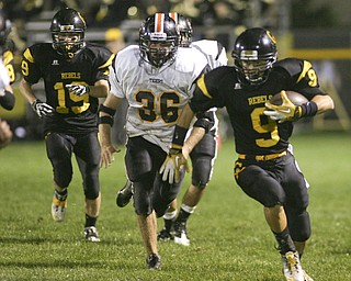 ROBERT  K.  YOSAY  | THE VINDICATOR --..Leading the team down the field #9 Crestviews  Collin Gilbert  races for a big gain with Springfields #36  Ryan Stacy in pursuit - behind them Crestviews #19 Nick Blower -  as the Crestview Rebels hosted the Springfield Tigers at Crestview Stadium ..--30-..(AP Photo/The Vindicator, Robert K. Yosay)