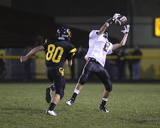 ROBERT  K.  YOSAY  | THE VINDICATOR --..Springfields #6 Tom Mastran hauls in a  big second quarter catch after beating #80  Tim Good  as the Crestview Rebels hosted the Springfield Tigers at Crestview Stadium ..--30-..(AP Photo/The Vindicator, Robert K. Yosay)