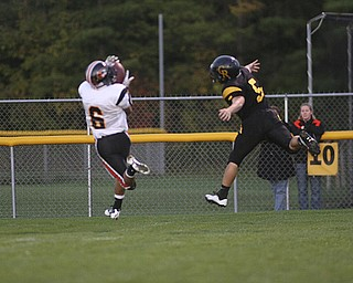 ROBERT  K.  YOSAY  | THE VINDICATOR --..DONT RUN BIG - Springfields #6 Tom Mastran pulls in a huge pass as Crestviews #5 Dillon Gorby tries to catch up..  He stepped out of bounds.. and Crestview later stopped the drive ---Crestview Rebels hosted the Springfield Tigers at Crestview Stadium ..--30-..(AP Photo/The Vindicator, Robert K. Yosay)