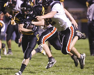 ROBERT  K.  YOSAY  | THE VINDICATOR --..Crestviews #19  Nick Blower drives through #2 Matt Chicase  and in for a TD during second quarter action v Crestview Rebels hosted the Springfield Tigers at Crestview Stadium ..--30-..(AP Photo/The Vindicator, Robert K. Yosay)