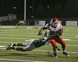 JESSICA M. KANALAS | THE VINDICATOR ..Ursuline's defensive back Anthony Davis, 1, tackles Steubenville's player during the second quarter of Friday night's game at YSU stadium.  ..-30