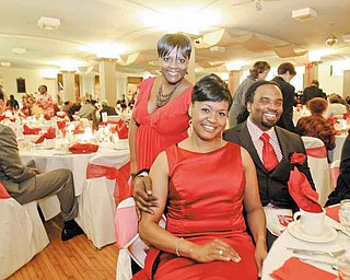 JESSICA M. KANALAS | THE VINDICATOR ..Tammy Hines of Tennessee, who has been a sister for 15 years, attends Delta Sigma ThetaÕs 10th annual Salute to Black Excellence along with Sharella Thomas, front, second vice president of the youngstown alumnae chapter, and Craig Stubbs, a member of the Omega Psi Phi of Youngstown. The event also marked the 60th anniversary of the sorority...-30