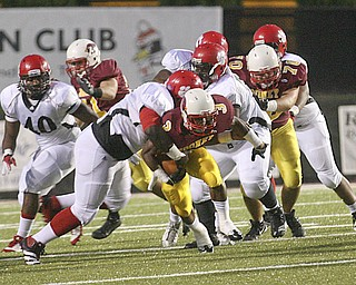 JESSICA M. KANALAS | THE VINDICATOR ..Mooney's senior running back Roosevelt Griffin breaks through the Red Lion Christian Academy's defense during Saturday night's game at YSU stadium. ..-30
