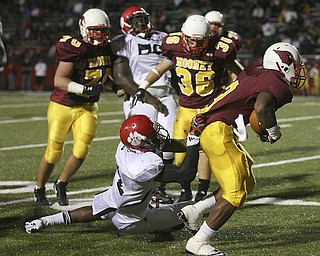 JESSICA M. KANALAS | THE VINDICATOR ..Mooney's senior running back Roosevelt Griffin is tackled by Red Lion Christian Academy's junior defensive back Neiko Creamer during the second quarter of Saturday night's game at YSU stadium. ..-30
