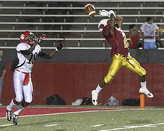 JESSICA M. KANALAS | THE VINDICATOR ..Mooney's junior cornerback Kareem Ellis almost intercepts a pass intended for sophomore wide receiver Frederick Canteen II of the Red Lion Christian Academy's during the second quarter of Saturday night's game at YSU stadium. ..-30