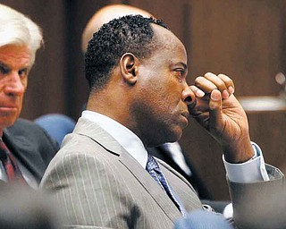 Conrad Murray wipes a tear during the defense opening arguments in his involuntary manslaughter trial at Superior Court, Tuesday, Sept. 27, 2011 in Los Angeles.  Murray has pleaded not guilty and  faces four years in prison and the loss of his medical license if convicted of involuntary manslaughter in Michael Jackson's death.  (AP Photo/Al Seib, Pool)