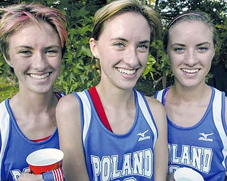 McKinsie Kilm, center, is flanked by her sisters Michelle, left, and Melissa, right, at the end of Mahoning County cross country meet Tuesday. McKinsie won the event. All three placed in top 10.