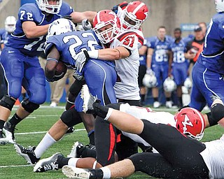 Youngstown State linebacker Ali Cheaib wraps up Indiana State running back Shakir Bell during their game Saturday in Terre Haute, Ind.