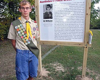 Austintown Fitch senior Alex While, 17, created a commemorative sign for Ed Wilhelm, a cross country runner for Fitch in the late 1970s who died while trying to save a girl from drowning in 1979. The sign, which also shows a map of Austintown Township Park and the current cross country course route, was installed at the finish line inside the park.