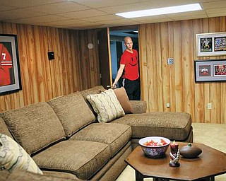 "After the room make-over, Dante DelSignore's basement became an official ""man cave,"" complete with football memorabilia and big screen TV. DelSignore, who was first diagnosed with bone cancer in 2007, saw the basement for the first time Thursday."