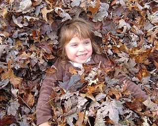 Joanne Shutrump of Boardman submitted this photo of her granddaughter, Bella Lettieri, 7, of Hatteras Island, N.C. Bella loves the leaves raked into a pile by her dad and mom, John and Mary Jill Shutrump Lettieri.