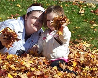 Jennifer and Mikayla Upright of Boardman enjoy the leaves and the fall weather. Photo submitted by Grandma Sheree Savon of Youngstown.