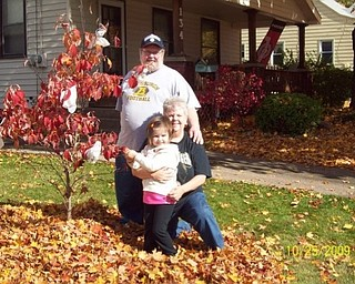 Mikayla Upright of Boardman decorates a Halloween tree with the help of her grandparents, Bob and Sheree Savon of Youngstown. Photo sent in by Sheree Savon.