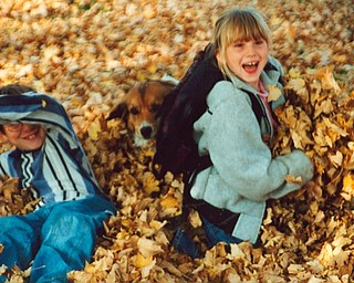 Lana Vannauker of Canfield sent in this photo of Leanna Hartsough playing in the leaves.