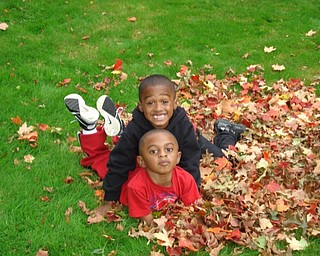 Stevie and Christian Woodberry of Youngstown enjoy their dad's yardwork. Photo submitted by T. Sharon Woodberry.