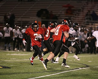 ROBERT K. YOSAY | THE VINDICATOR...#3   Bryce Jackson -  follows  #48   Jimmy Rousher as he scrambles for a first down as .East  Panthers at Canfield Cardinals .....-30
