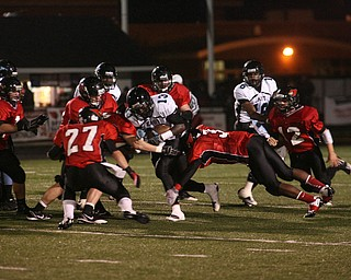 ROBERT K. YOSAY | THE VINDICATOR..East #13  George LeFlore  as he was stopped  by #27  Ben Angelo  #3  Bryce Johnson #12  Mike Hughes ... ..East  Panthers at Canfield Cardinals .....-30