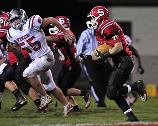 Running back Nick Pollifrone #21 of Struthers looks for room around the edge on a running play.
