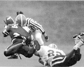 01/17/91 - Doug Oster.The Catch: Herb Williams makes the play off the game tto keep YSU alive. Chuck Murrya of Villanova is defending. On 4th and 11 with 1:12 left and YSU down by two, Ray Issac threw a pass to Williams. He had contact with the defender and the ball was tipped and on the way back down, Williams made the catch.