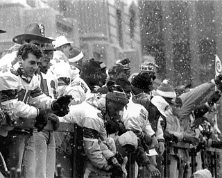 01/17/91 - Doug Oster.YSU Parade: YSU team on a flatbed as people cheer for them.