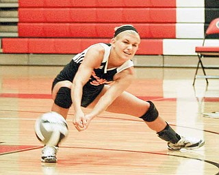 Springfi eld senior Sarah Sauerwein digs the ball during the Tigers' match at Girard High on Monday.