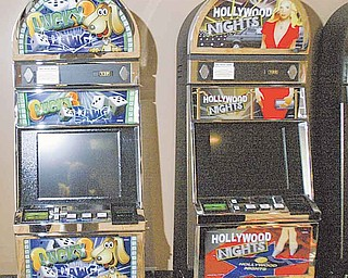 A sweepstakes machines sits idle at Silver Star Internet café while its owner Bill Pilorusso resolves a dispute with Hubbard Township over regulation of Internet cafés.