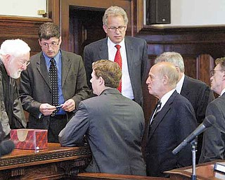 Visiting Judge William H. Wolff Jr. of Mahoning County Common Pleas Court huddles with special prosecutors and lawyers for the Cafaro defendants and defendant John Zachariah during a Monday hearing concerning whether records in the now-dismissed Oakhill Renaissance Place criminal conspiracy case should be sealed from public view.