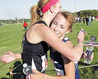 William D Lewis The Vindicator  Fitch runner Carissa Jenkins, right hugs Canfield's Emma Lunne after winning meet at Canfield Tuesday 10--11. Lunne finished 2nd