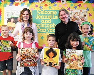 Illustrators Jeanette and Christopher Canyon spoke to students at Dobbins Elementary School  on Friday. From left, Jacob Antil, 9; Brooke Chandler, 7; Mike Nicholudis, 6; Isabella Khoury, 5; and Emily Frost, 9, display works illustrated by the Canyons.